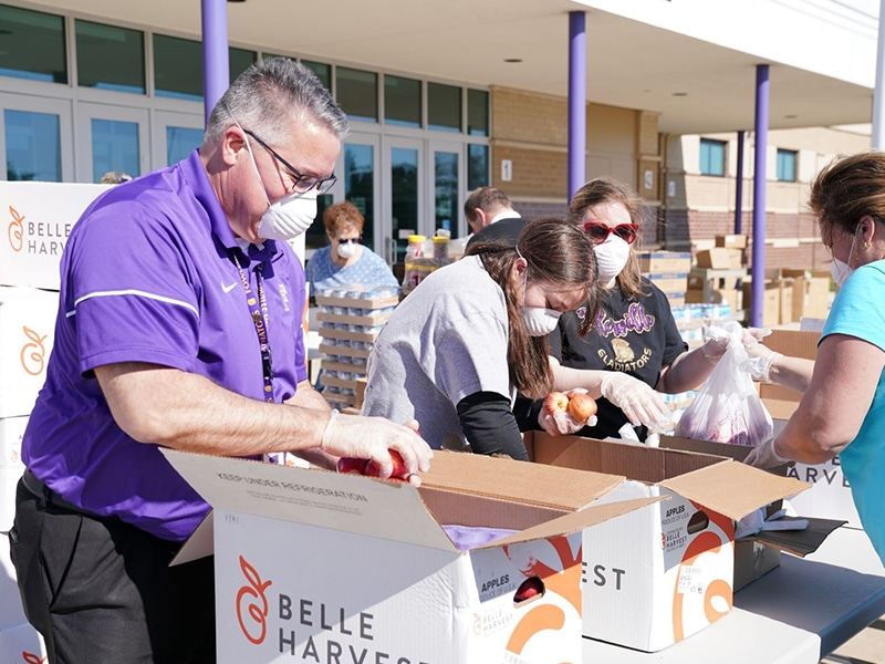 Wayne Roedel, Fowlerville Community Schools Superintendent, volunteers at the Gleaners mobile food distribution