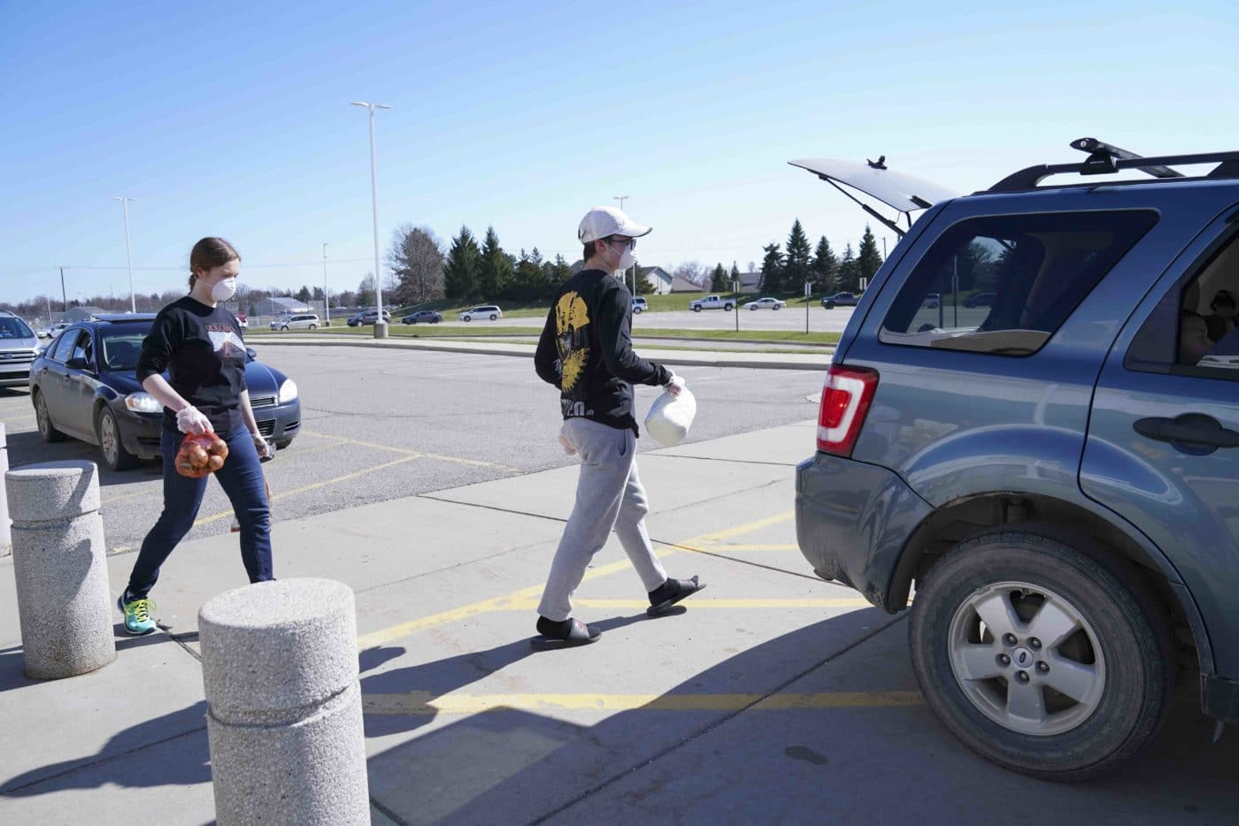 Drive-up food distribution at Fowlerville High School