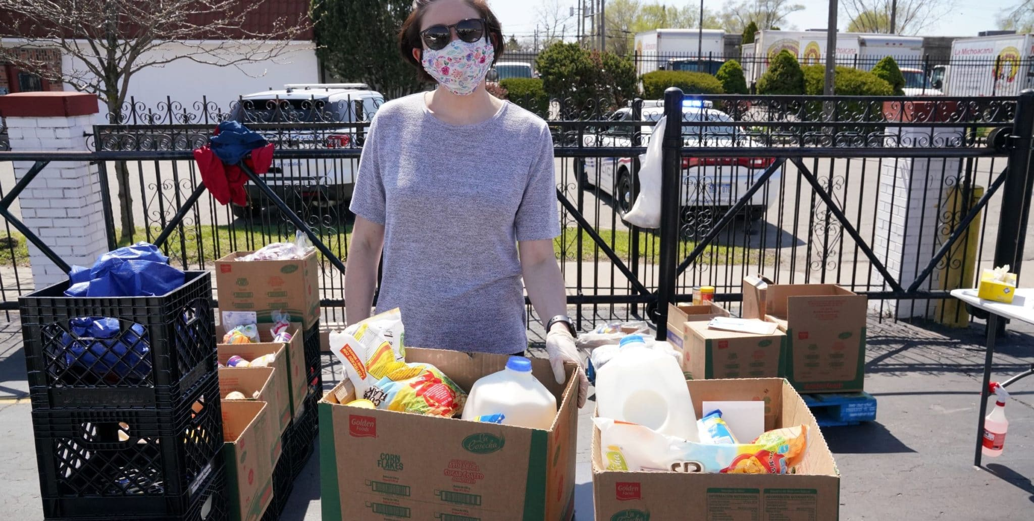 Gleaners staff packs boxes of emergency groceries at a food distribution in Detroit, Michigan.