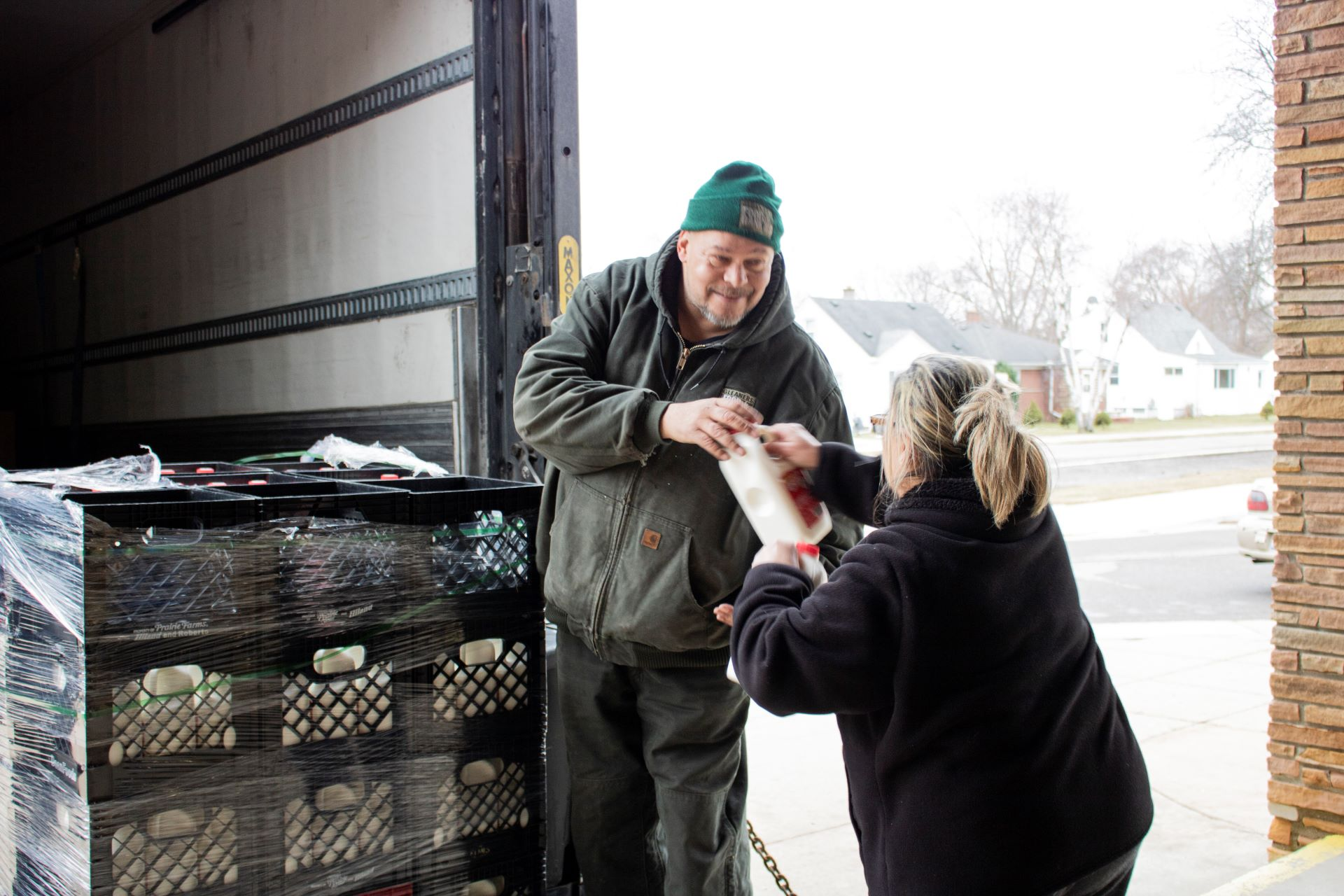 Gleaners staff distributes fresh milk at a School Food Mobile at McKinley Elementary School