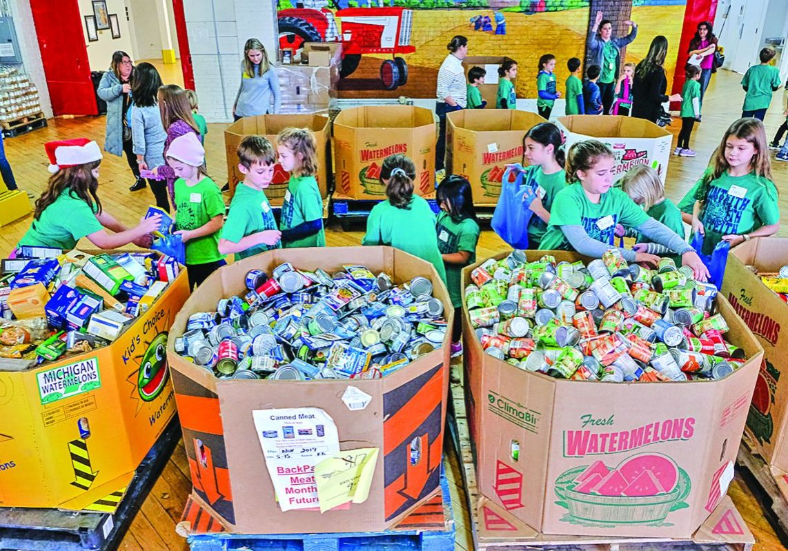 Monteith Elementary School Student Council held a good drive at the school to benefit Cleaners Food Bank of Southeastern Michigan and here they are at Detroit Gleaners sorting food.